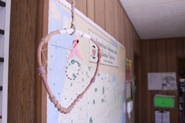Traditional Native American crafts decorate the modest trailer that is the headquarters for the Navajo AIDS Network. This dreamcatcher holds a red AIDS awareness ribbon.