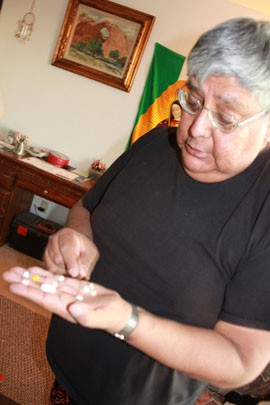 Navajo AIDS Network volunteer Jerry Archuleta takes 16 pills morning and night to treat his HIV.