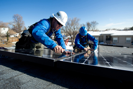 Workers install solar panels on a Colorado house in his 2011 file photo. Installation continued to be the largest job category in Arizona's solar-energy industries in 2014, a new report says.