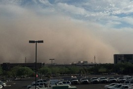 A dust storm approaches downtown Phoenix on Aug. 11, 2012. Health officials say summer storms spawning haboobs increase cases of Valley Fever. (Photo Courtesy of the National Oceanographic and Atmospheric Administration)