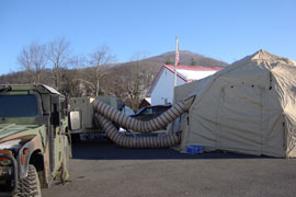 Power is still out in parts of West Virginia after snowstorms following the remnants of Hurricane Sandy last week. So the National Guard set up these heated lighted tents to act as temporary poling places in Tucker County, W.Va.