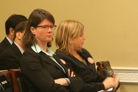 An unhappy Jennifer Krill, executive director of Earthworks, sits after testifying that the proposed Resolution Copper mine in Arizona would would pollute the area and deprive people of access to recreational and sacred lands.