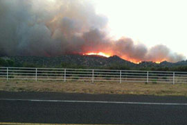 The Yarnell Hill wildfire had burned over more than 8.300 acres by Monday, officials said.
