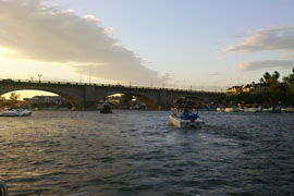 Boats cruise on the Colorado River's Lake Havasu, where part of the local economy is reliant on the tourism and boating industries the river attracts.