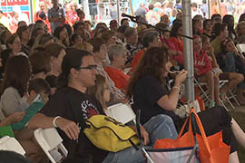 Scores of fans, of all ages, turned out at the National Book Festival to hear Monica Brown, a children's book author from Arizona who often writes about Hispanic subjects and themes.