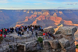 Crowds gather watch thunderheads building over the North Rim of the Grand Canyon from Mather Point on the South Rim in August 2011