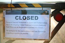 A sign on the gate at Tuzigoot National Monument informs visitors why the facility is closed.
