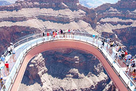 The Grand Canyon Skywalk, a glass-bottomed walkway takes visitors out to a point that is 4,000 feet above the Colorado River below, is a main attraction of the western rim of the Grand Canyon, which is owned by the Hualapai Indians.