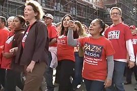 Phoenix resident Gina Sanchez, shown here in the Paz Accion shirt during an October immigration rally in Washington, was back in town this week to join in a fast to bring attention to the issue.