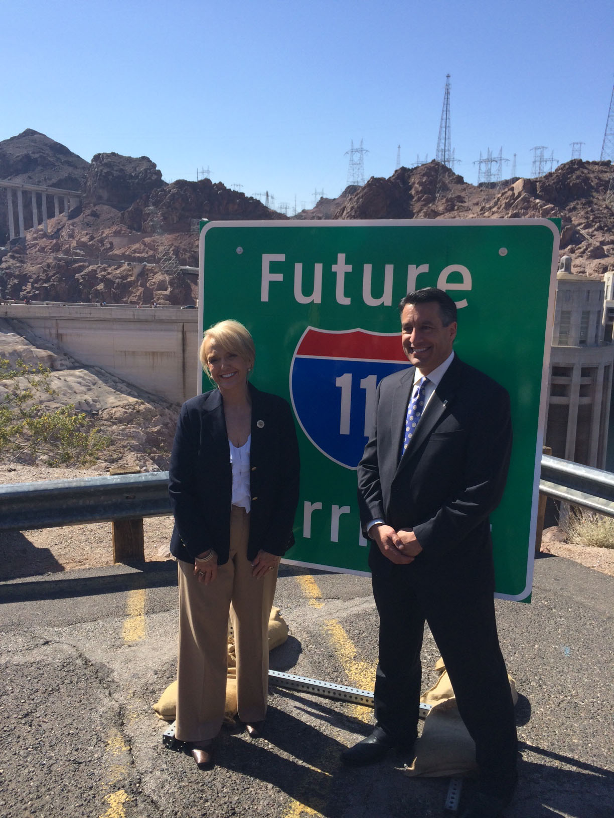 Arizona Gov. Jan Brewer and Nevada Gov. Brian Sandoval unveiled signs flast month or the planned Interstate 11 along its route near the Hoover Dam. (Photo courtesy Nevada Governor's Office)