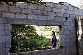 Virgil Edwards looks over an abandoned home in Chiapas, Mexico that was burned after an indigenous group attempted to claim Edwards' land in October 2012.