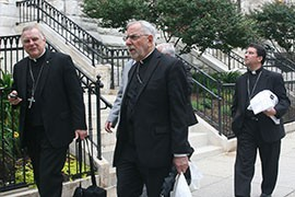 Tucson Bishop Gerald Kicanas, center, walks with Miami Archbishop Thomas G. Wenski, left, and Las Cruces, N.M., Bishop Oscar Cantu outside St. Peter's Roman Catholic Church in Washington. They were in town to push for immigration reform.