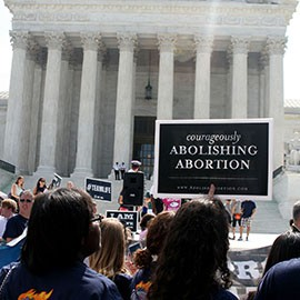 Pro-life advocates protest in front of the Supreme Court, which said business owners could not be forced to provide contraceptive coverage if it violates their strongly held religious beliefs.