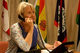 Peace Corps Director Carrie Hessler-Radelet works the phones at the corps' headquarters in Washington as the agency reaches out to more than 30,000 people who started, but never finished, an application to serve. it is part of a larger effort to boost recruits to the corps