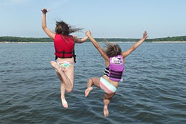 Advocates say that water-safety lessons need to be observed in all bodies of water, including canals, rivers and ditches, and not just swimming pools. Life vests like those used by the children in this Missouri file photo should be used, they say.