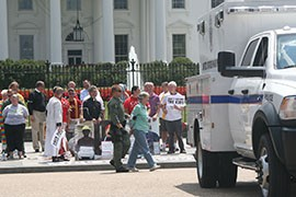 A protester is cuffed and led away by police during the anti-deportation demonstration outside the White House.