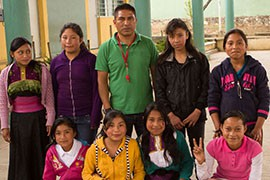 Teacher Octavio Santis with his fifth-grade girls basketball team at the Benito Juarez School. Some girls take to the court in traditional Tzotzil garb at the bilingual school, where Tzotzil and Spanish are spoken.