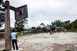 Basketball courts like this one dot the Mexican state of Chiapas, where the sport competes with soccer for fan attention. Or, as here, where the two sports come together, as soccer players use a basketball court for an impromptu game.