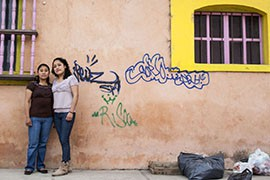 Nursing students Maria Luna, left, and Susana Patricia Lopez outside La FOMMA, the organization that provided scholarships to help funds their nursing school tuition.