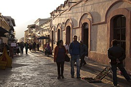 Tourists walk the streets of San Cristobal de las Casas, a popular tourist destination in Chiapas, Mexico, where the Zapatistas led an uprising against the Mexican government 20 years ago.
