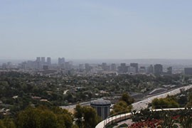 A haze over the Los Angeles skyline. Agreements between California and Mexico aim to reduce carbon emissions while preserving forests and protecting indigenous people.