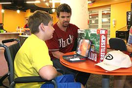 Arizona Diamondbacks catcher Tuffy Gosewisch plays a board game with a boy at Phoenix Children's Hospital.