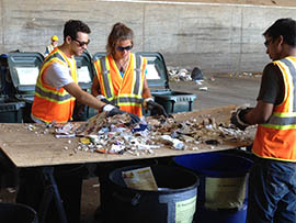 Arizona State University students Andy Stein and Cassie Lubenow sort through refuse as part of a trash study meant to increase recycling in Phoenix.