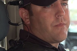 A Mesa police officer wears a Taser-produced body camera on his hat during a test earlier this year. The cameras capture everything an officer sees, and does, in real time.