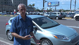 Jim Stack stands in front of his Ford Focus electric and explains the benefit behind an all-electric car.