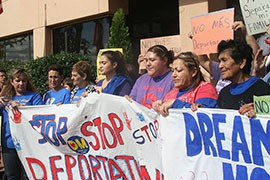 Arizona residents Andrea Adum, fourth from right, and Mayra Canales, to her left, were arrested at an immigration reform protest at the Democratic National Committee.