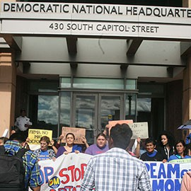 Mayra Canales, center, and others protest the lack of action on immigration reform outside Democratic National Committee headquarters. Canales was later arrested in the protest.
