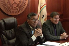 Navajo Nation President Ben Shelly, left, and Navajo Council Speaker Pro Tem LoRenzo Bates announced in May that the tribe had accepted a $554 million settlement of its lawsuit against the federal government. The deal will be formally signed Friday with Obama administration and tribal officials in Window Rock