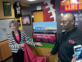 Sherry Henry, executive director of Arizona Office of Tourism, and Terry Williams, sales and service manager for the Glendale Convention and Visitors Bureau, address a February 2014 news conference counting down to the 2015 Super Bowl in Arizona.