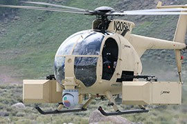 Arizona agencies have received nine military helicopters from program 1033, two of which were originally attack helicopters like this MH-6/AH-6