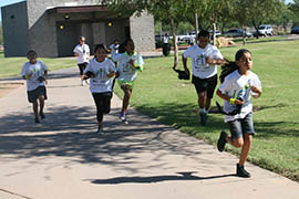 Students from Excelencia School explore a new geocaching tour at Steele Indian School Park.