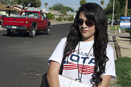 Betzy Solis knocks on doors in a Mesa neighborhood on behalf of Mi Familia Vota, part of the One Arizona coalition seeking to get more Hispanics to vote and sign up for the early voting list.
