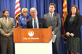 Tucson Mayor Jonathan Rothschild addresses a news conference at which he and Phoenix Mayor Greg Stanton announced an agreement for Phoenix to store some of its Central Arizona Project allotment in aquifers to the south.
