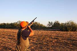 Hunter Lopez takes aim at a dove.