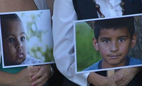 Advocates held photos of foster children during an April 2013 rally af the Arizona State Courts Building in Phoenix.