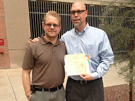 Michael Berg and Rodney Eckersley display their marriage license outside Maricopa County Superior Court on the same day a federal judge overturned Arizona's same-sex marriage bans. The two said they had waited 18 years for the right to marry.