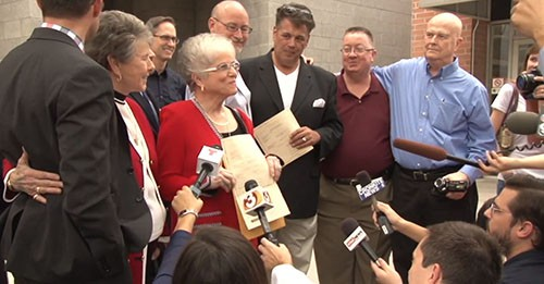 Karen Majors holds the certificate for her marriage to Nelda Majors, left, a lead plaintiff in one of the suits that brought down Arizona's same-sex marriage ban. They were married Friday after 57 years. Cronkite News' <b>Mackenzie Scott</b> and <b>Sierra Oshrin</b> were there for the ceremony.
