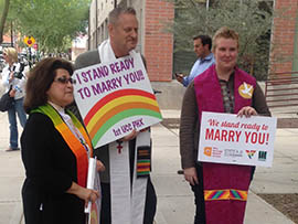 Ministers wait outside Maricopa County Superior Court, ready to marry couples who sought marriage licenses after a federal  judge on Friday struck down Arizona's ban on same-sex marriage.