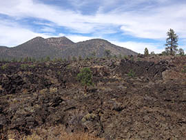 The cinder dome of the Sunset Crater volcano dominates the landscape at Sunset Crater National Park.
