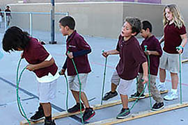 Students at the Arizona State University Preparatory Academy in Phoenix take part in the Healthy Kidas after-school program in 2013.