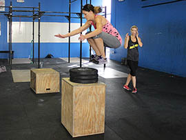 A CrossFit Incite member executes a box jump, a typical CrossFit exercise, at the gym in Mesa.