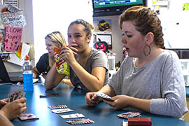 Sixteen-year-old Raven Evans, who volunteers with the Parker Area Alliance for Community Empowerment, plays cards with other kids at the 9th Street Youth Center.