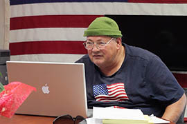 Richard Findley, a homeless veteran, reads the news on his laptop at the Veterans Resource Center in Prescott.