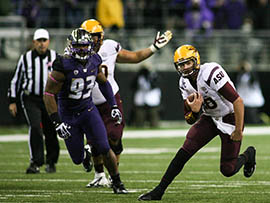 Quarterback Taylor Kelly rushes against Washington in his return from injury.