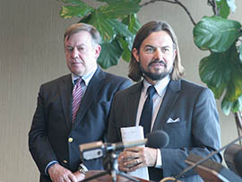 Brad Snyder, executive director of the Dion Initiative for Child Well-Being and Bullying Prevention, addresses a news conference with Arizona State University President Michael M. Crow.