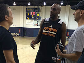Anthony Tolliver (center) talks with reporters after a Phoenix Suns practice Wednesday. The Phoenix Suns hope Tolliver, a 6-foot-8 stretch forward signed in free agency, will help replace the points and presence of Channing Frye.